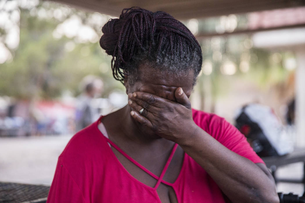 Rosslyn Hubbard wipes tears from her eyes as she talks about the circumstances that caused her homelessness on Thursday, July 27, 2018, at the city of Las Vegas' homeless courtyard. The courtyard ...