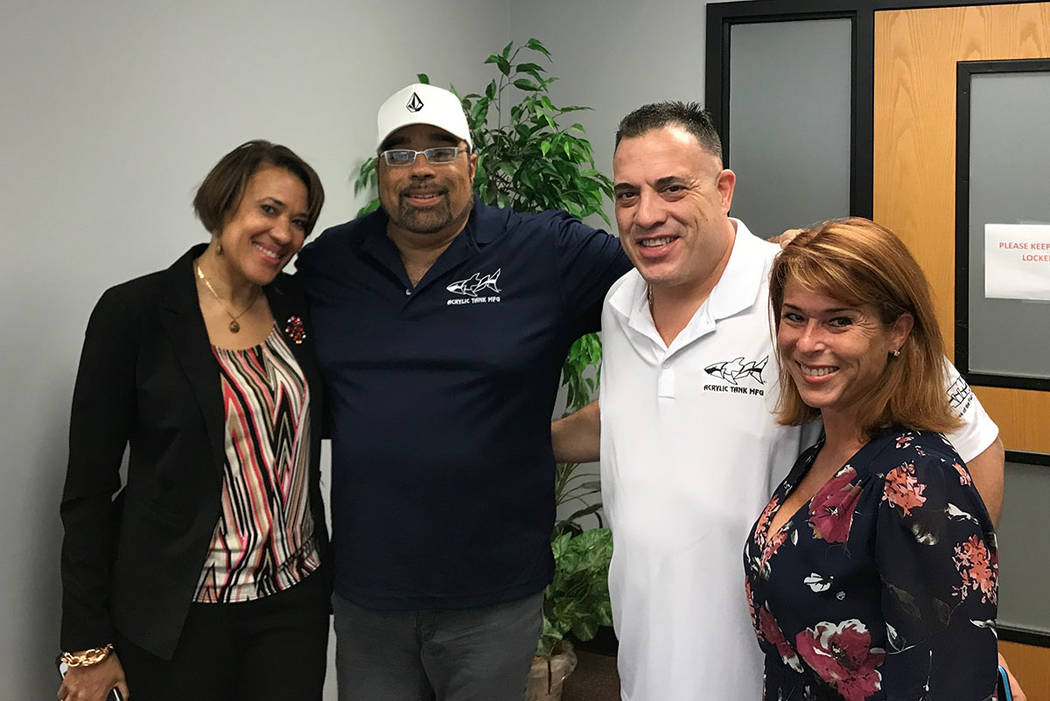 "Flint, Mich. Mayor Mayor Karen Weaver; Las Vegas entertainment producer Frank DiMaggio; Wayde King of ""Tanked""; and King's wife, Heather are shown on Thursday, July 26, 2018 at Weaver's office. (W ..."