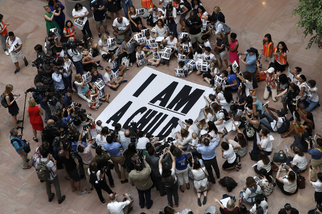 Families with young children protest the separation of immigrant families with a sit-in at the Hart Senate Office Building, Thursday, July 26, 2018, on Capitol Hill in Washington. (AP Photo/Jacque ...