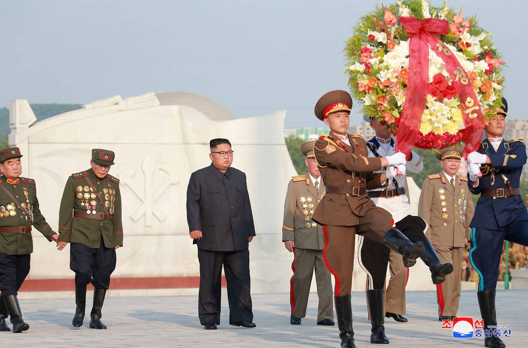 In this July 26, 2018, photo, North Korean leader Kim Jong Un, center, visits the tombs, on the 65th anniversary of the signing of the ceasefire armistice that ends the fighting in the Korean War, ...