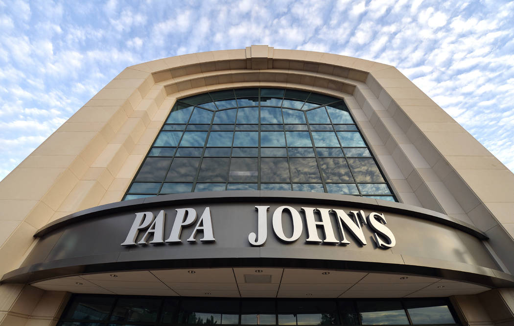 This July 17, 2018, file photo, shows the corporate headquarters of Papa John's pizza located on their campus, in Louisville, Ky. (AP Photo/Timothy D. Easley, File)