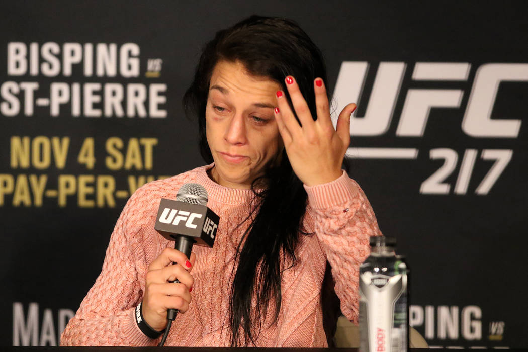 Joanna Jedrzejczyk answers media questions after losing her strawweight title at the UFC 217 post-fight news conference at the Madison Square Garden theater on Saturday, Nov. 4, 2017 in New York, ...