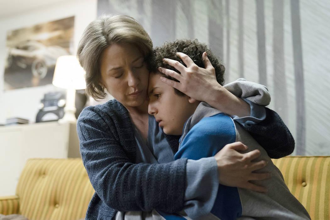 "Carrie Coon as Vera Walker, Elisha Henig as Julian on ""The Sinner."" (Photo by: Peter Kramer/USA Network)"