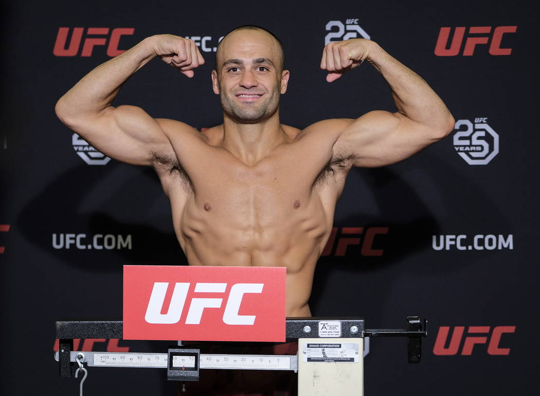 UFC lightweight fighter Eddie Alvarez flexes during weigh-ins , Friday, July 27, 2018 in Calgary, Alberta.. (Jeff McIntosh/The Canadian Press via AP)