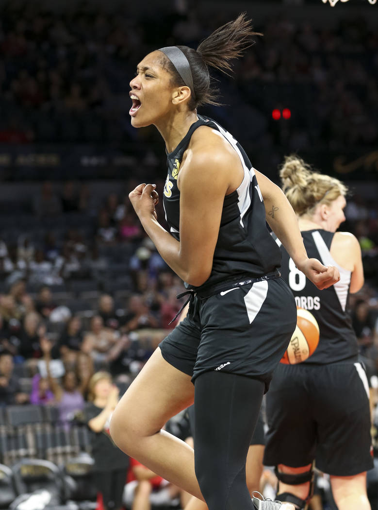 Las Vegas Aces center A'ja Wilson (22) reacts after getting fouled during the first half of a WNBA basketball game against the Indiana Fever at the Mandalay Bay Events Center in Las Vegas on Sunda ...