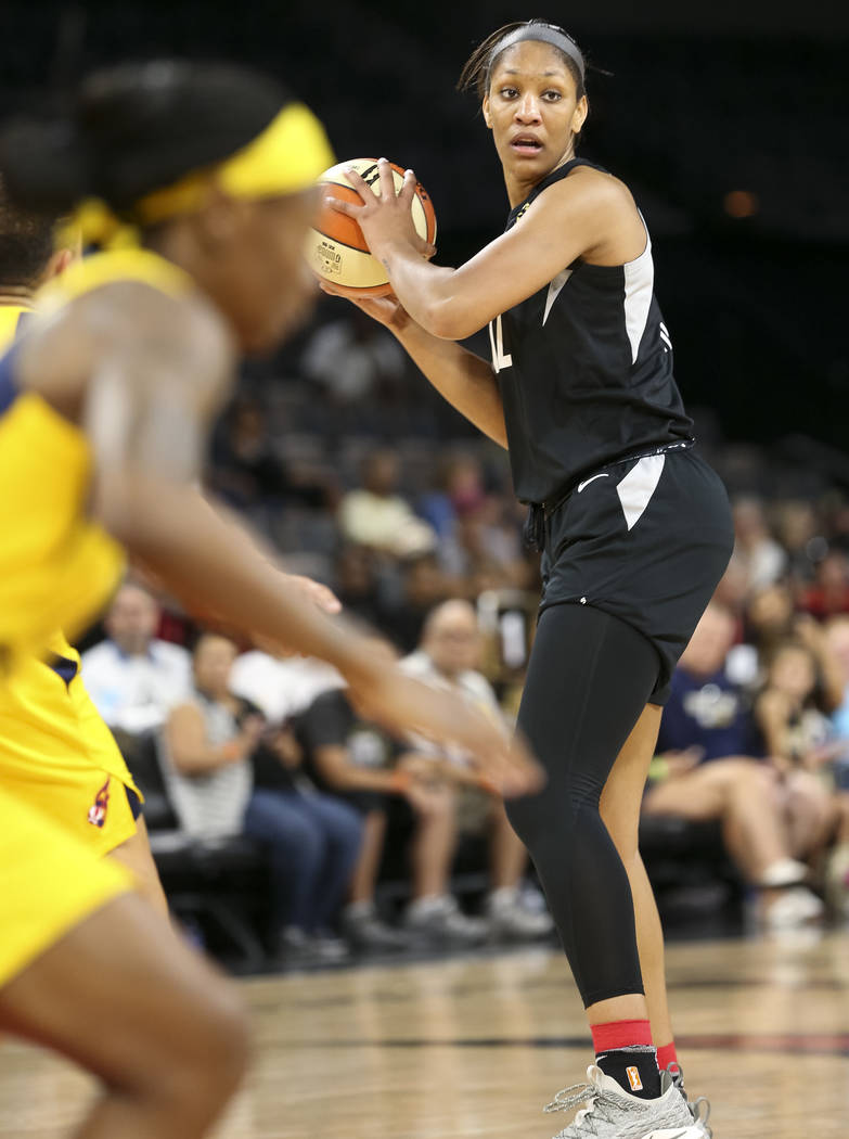 Las Vegas Aces center A'ja Wilson (22) looks for a receiver against the Indiana Fever during the first half of a WNBA basketball game at the Mandalay Bay Events Center in Las Vegas on Sunday, July ...
