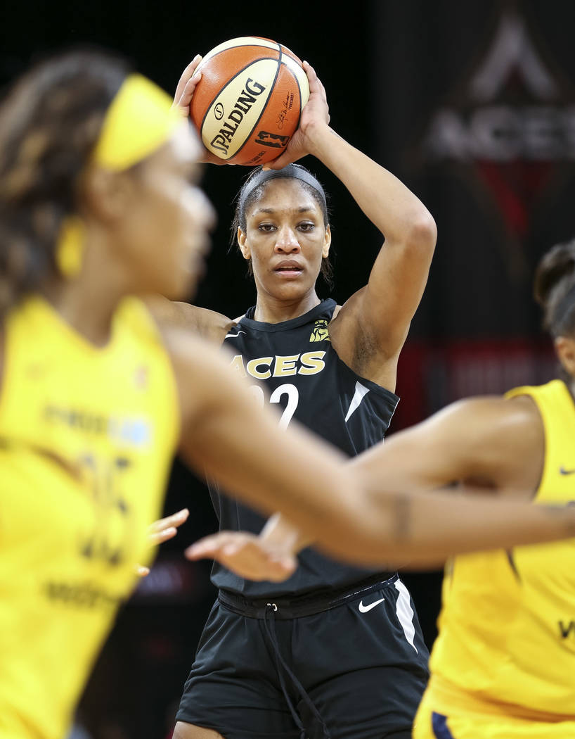 Las Vegas Aces center A'ja Wilson (22) looks to pass against the Indiana Fever during the first half of a WNBA basketball game at the Mandalay Bay Events Center in Las Vegas on Sunday, July 22, 20 ...