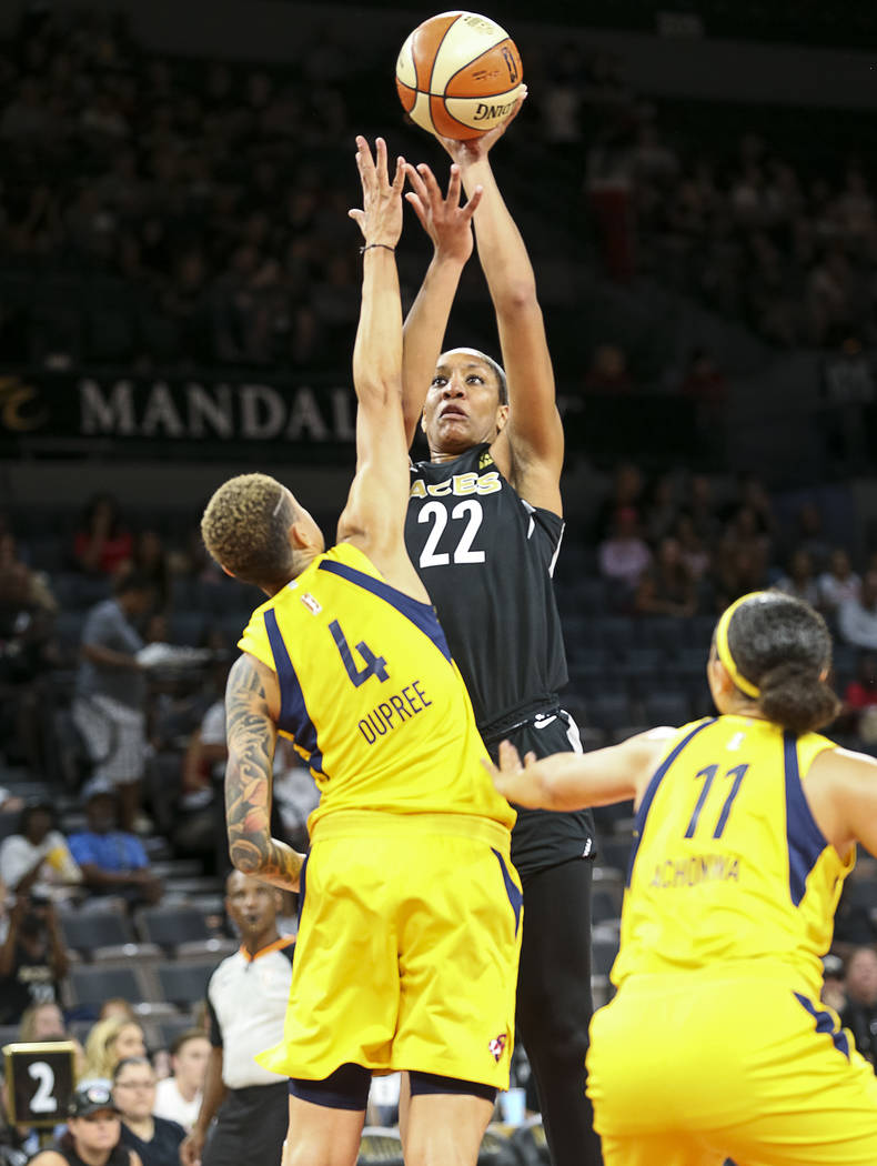 Las Vegas Aces center A'ja Wilson (22) shoots over Indiana Fever forward Candice Dupree (4) during the first half of a WNBA basketball game at the Mandalay Bay Events Center in Las Vegas on Sunday ...