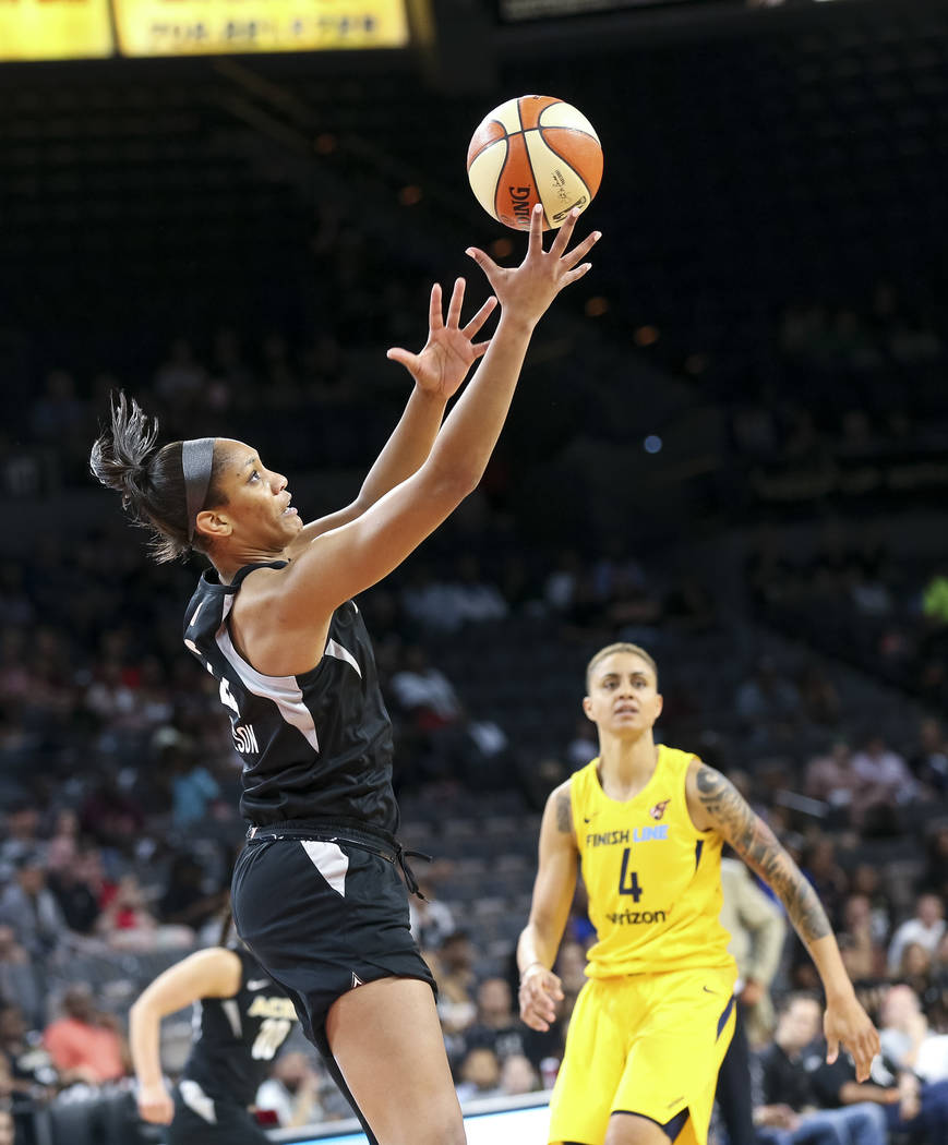 Las Vegas Aces center A'ja Wilson (22) pulls in the rebound as Indiana Fever forward Candice Dupree (4) heads down court during the first half of a WNBA basketball game at the Mandalay Bay Events ...