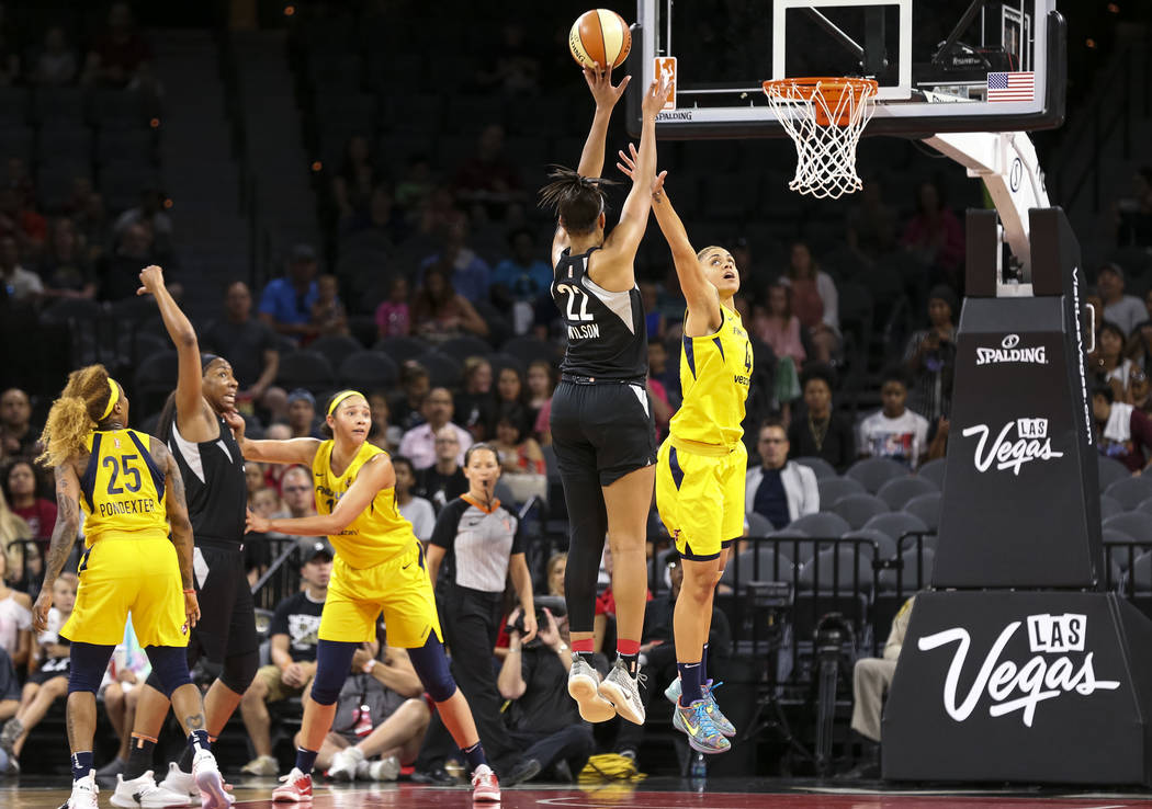 Las Vegas Aces center A'ja Wilson (22) takes a shot over Indiana Fever forward Candice Dupree (4) during the first half of a WNBA basketball game at the Mandalay Bay Events Center in Las Vegas on ...