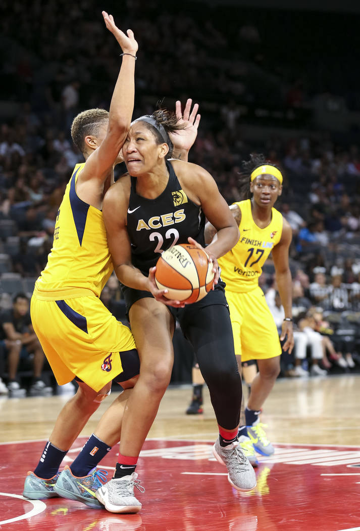 Las Vegas Aces center A'ja Wilson (22) drives the ball against Indiana Fever forward Candice Dupree (4) during the first half of a WNBA basketball game at the Mandalay Bay Events Center in Las Veg ...
