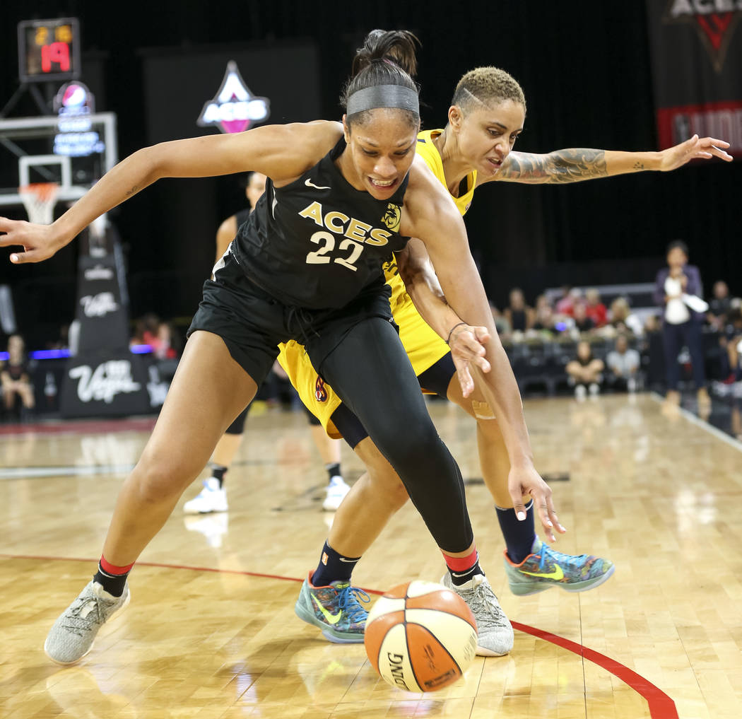 Las Vegas Aces center A'ja Wilson (22) and Indiana Fever forward Candice Dupree (4) battle for the ball during the first half of a WNBA basketball game at the Mandalay Bay Events Center in Las Veg ...