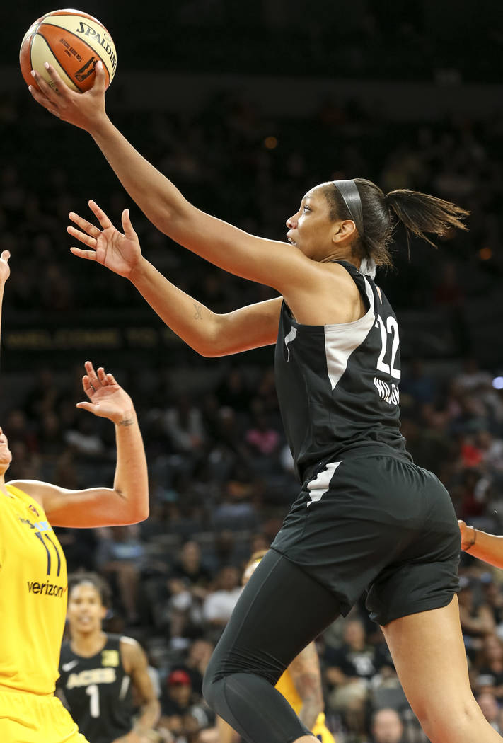Las Vegas Aces center A'ja Wilson (22) goes up for a shot over Indiana Fever forward Natalie Achonwa (11) during the second half of a WNBA basketball game at the Mandalay Bay Events Center in Las ...