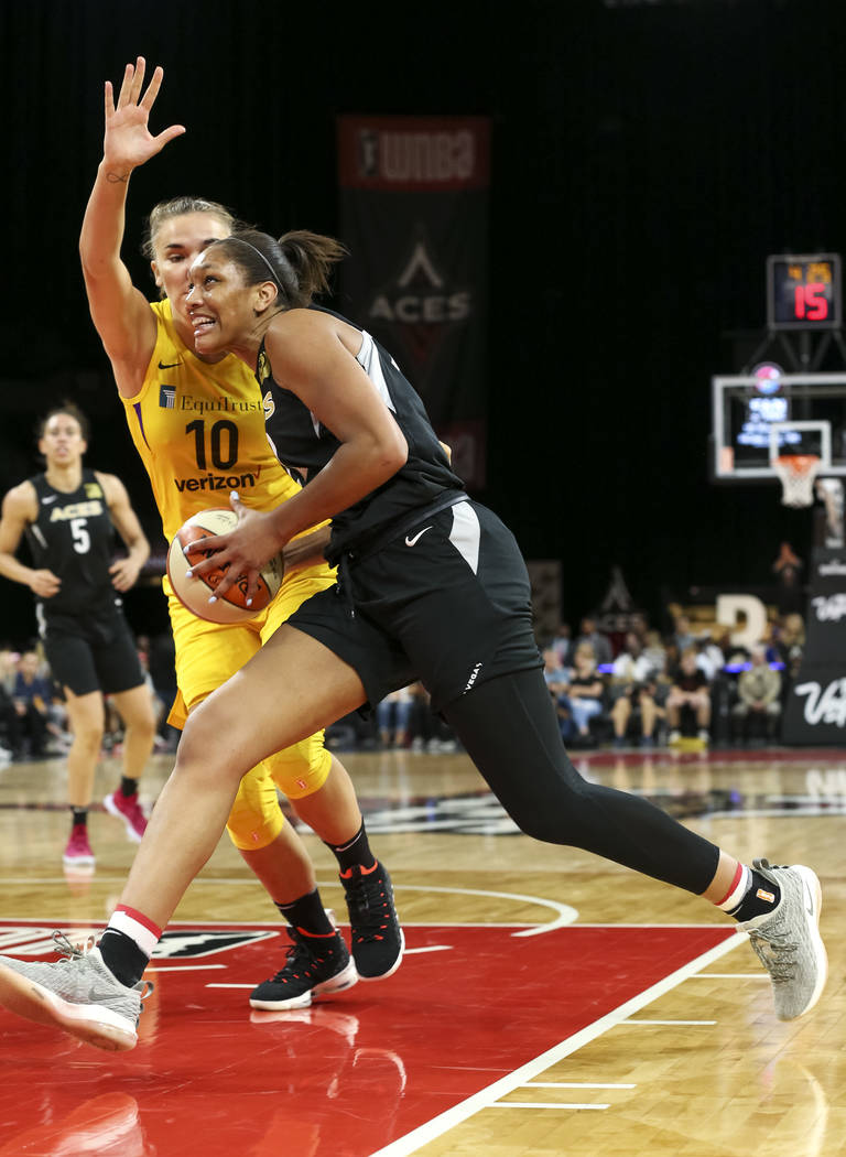 Las Vegas Aces center A'ja Wilson (22) drives to the net against Los Angeles Sparks center Maria Vadeeva (10) during the second half of a WNBA basketball game at the Mandalay Bay Events Center in ...