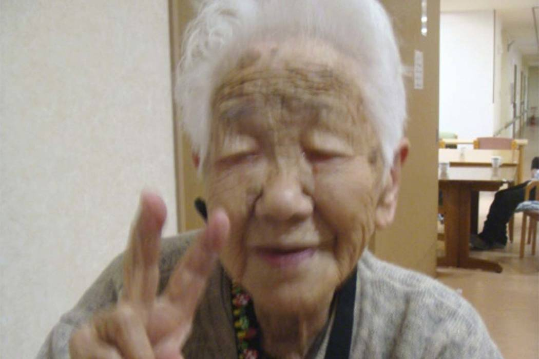 In this Jan. 2, 2018, photo provided by Goodtime Home 1, Kane Tanaka flashes a peace sign during her 115th birthday celebration at her nursing home in Fukuoka, southwestern Japan. Tanaka became th ...