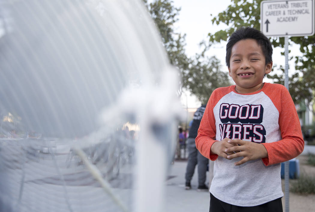 Axel Sampedro, 7, reacts as he jumps in front of a water mister during the Citywide Traffic Safety Block Party hosted by the Las Vegas Metropolitan Police DepartmentÕs traffic bureau at Veter ...