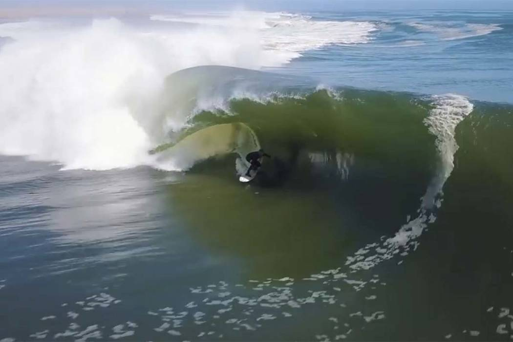 In this image made from video provided by Chris Rogers, surfer Koa Smith rides a wave off the coast of Namibia, on the Western shore of Africa. Smith rode for nearly a mile over a 120-second span ...