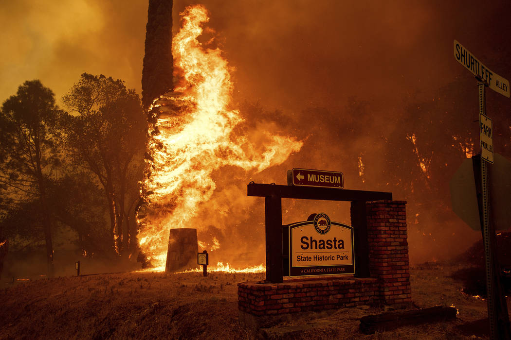 The Carr Fire tears through Shasta, Calif., Thursday, July 26, 2018. Fueled by high temperatures, wind and low humidity, the blaze destroyed multiple homes and at least one historic building. (AP ...