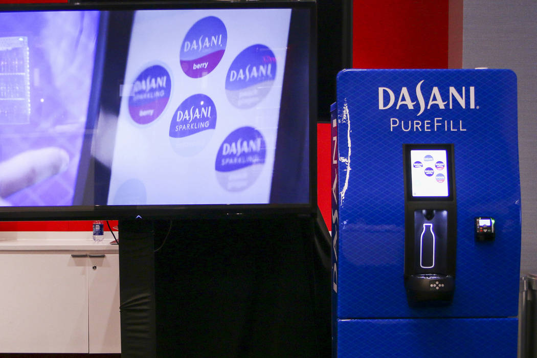 "This undated photo provided by Coca-Cola shows the company's ""Dasani Purefill"". The company is testing the machine on the campus of Georgia Tech that lets people fill reusable water bottles ..."