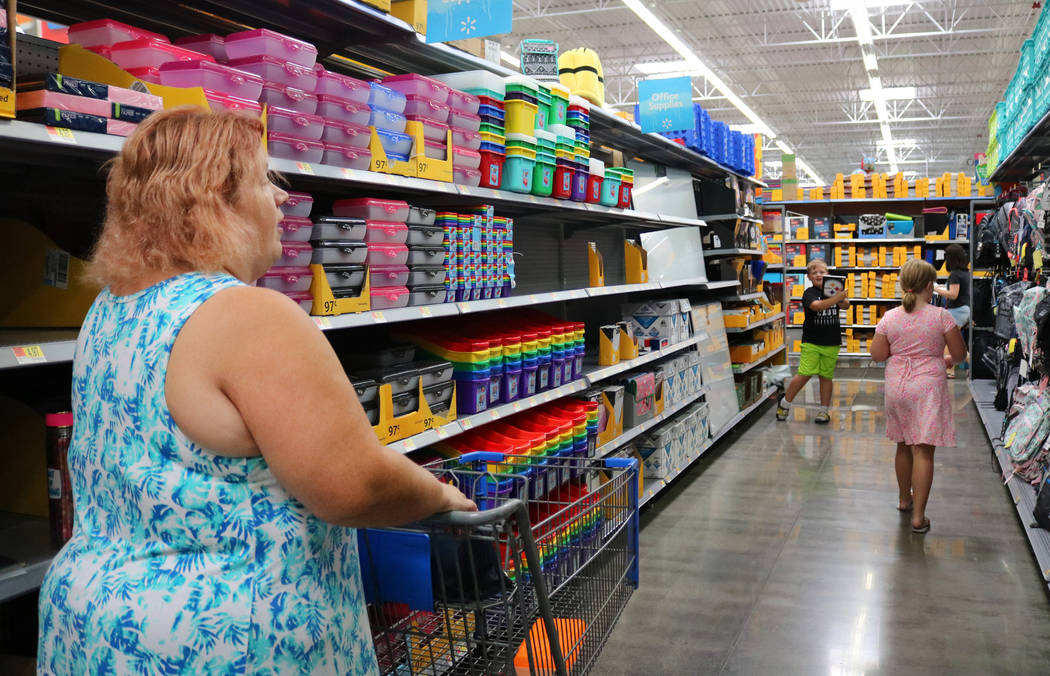 Laura LeBowsky, left, shops for school supplies with her children Brady, 6, and Chloe, 8, at Walmart in Las Vegas, Thursday, July 26, 2018. (Madelyn Reese/Las Vegas Review-Journal) @MadelynGReese