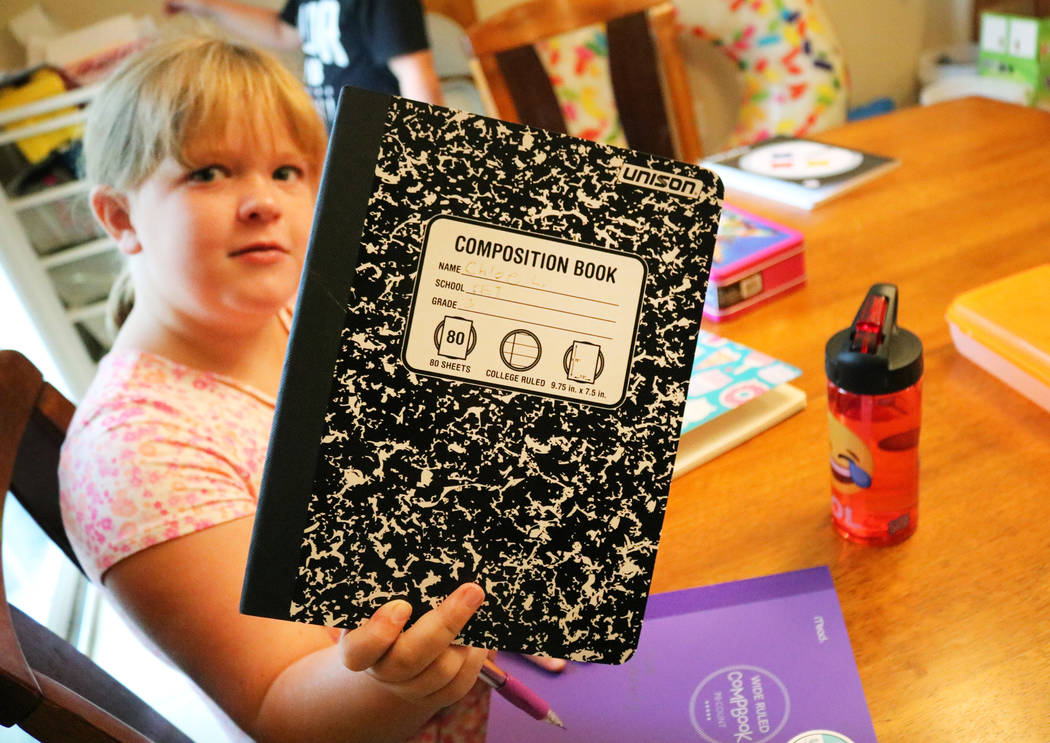 Chloe LeBowsky, 8, shows off her new notebooks for the upcoming school year in Las Vegas, Thursday, July 26, 2018. (Madelyn Reese/Las Vegas Review-Journal) @MadelynGReese
