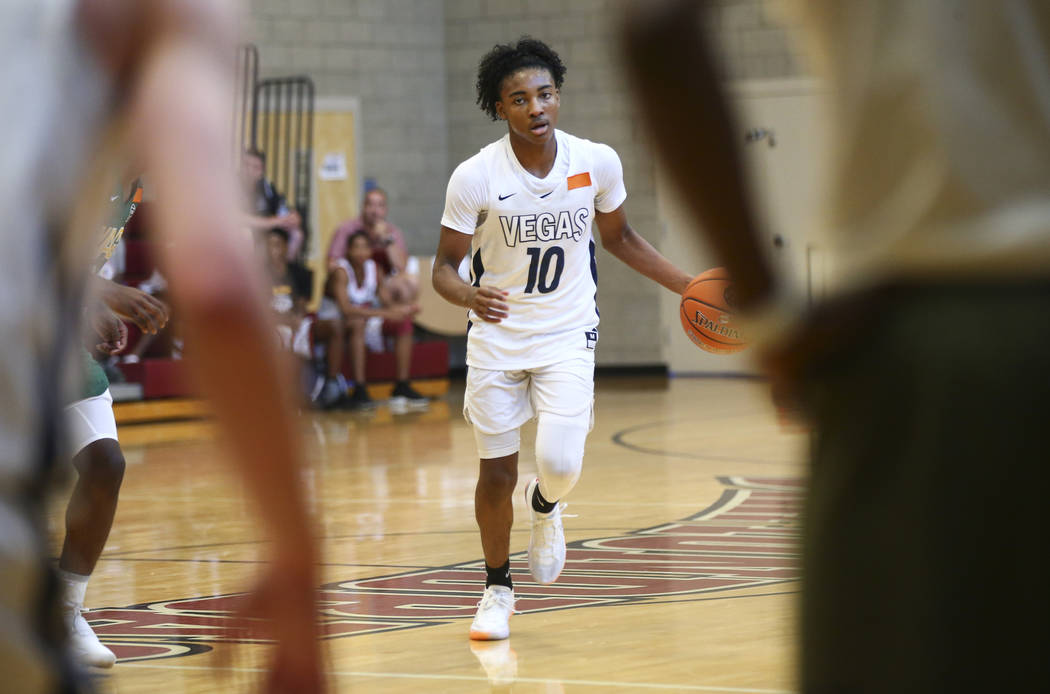 Vegas Elite guard Zaon Collins (10) brings the ball up court while playing against We All Can Go as part of the Fab 48 tournament at Desert Oasis High School in Las Vegas on Friday, July 27, 2018. ...