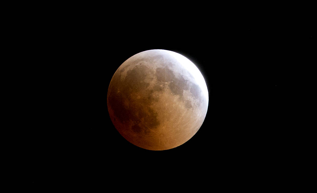 A blood moon rises over Gaza City, Friday, July 27, 2018. Skywatchers around much of the world are looking forward to a complete lunar eclipse that will be the longest this century. The so-called ...