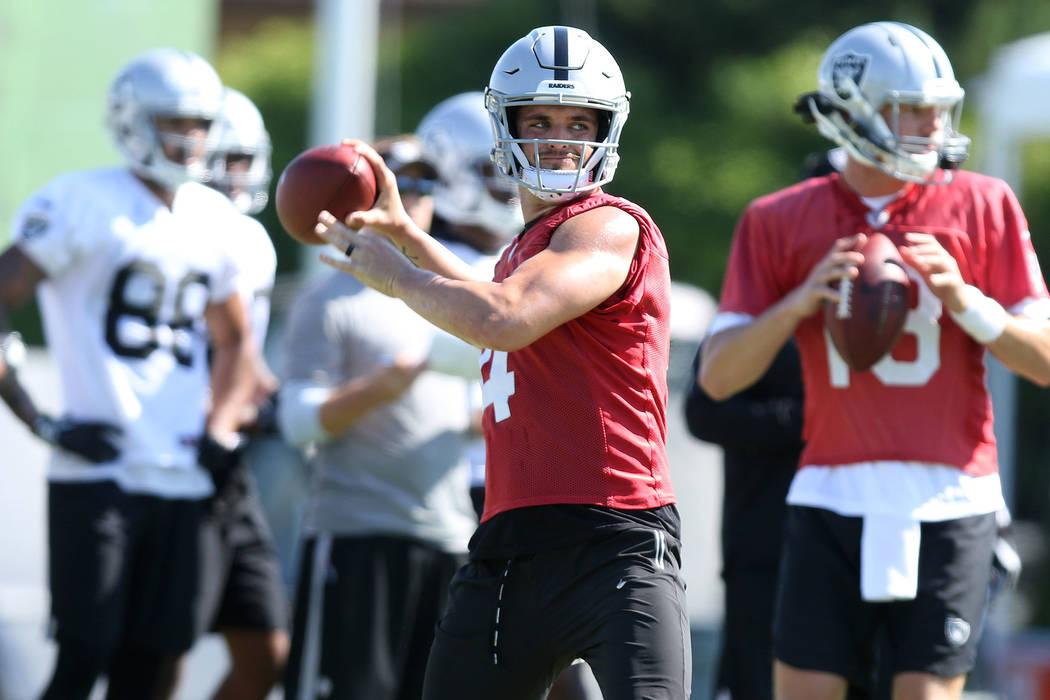 Quarterback Derek Carr (4) prepares to throw the football at the Oakland Raiders training camp in Napa, Calif., Friday, July 27, 2018. Heidi Fang Las Vegas Review-Journal @HeidiFang