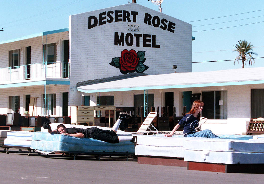 Furniture, TV sets and beds sit in the parking lot at the Desert Rose Motel on Feb. 5, 1995. Only a sign in the Neon Museum Boneyard remains of the motel now. (John Gurzinski/Las Vegas Review-Journal)