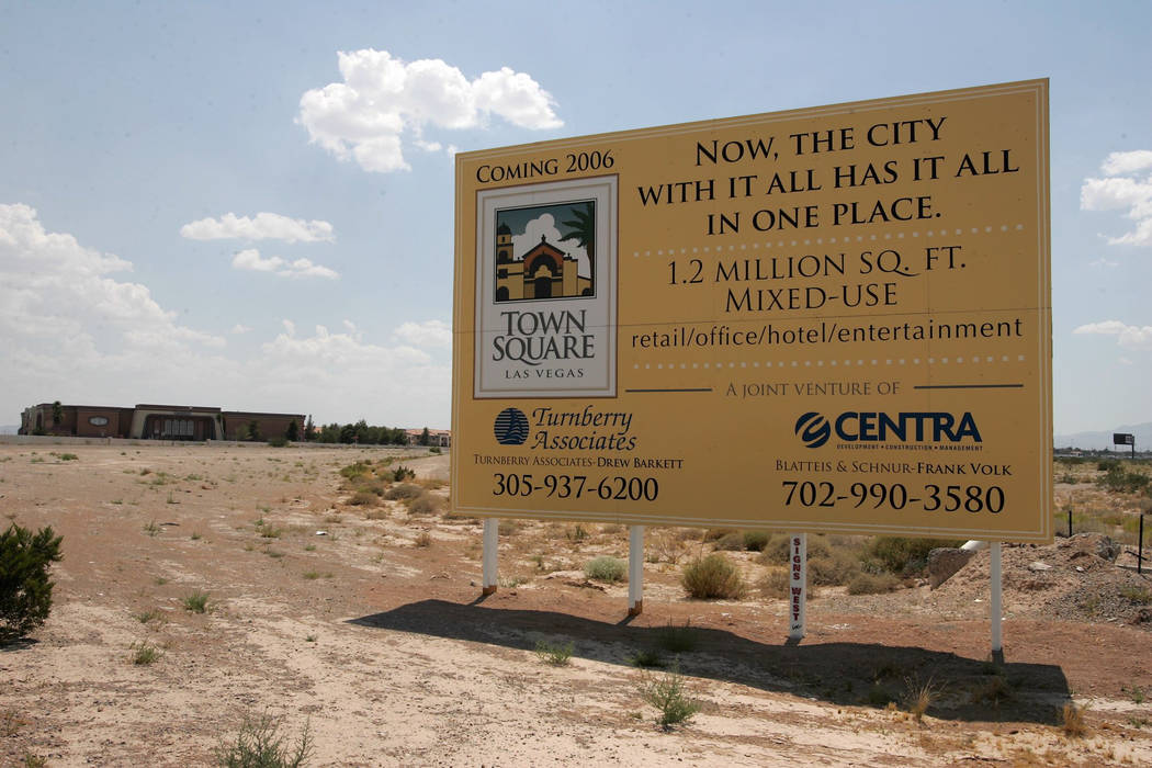 A sign announces the 2006 coming of Town Square shopping center in this July 19, 2004, photo with the vacant Vacation Village in the background. (John Gurzinski/Las Vegas Review-Journal)