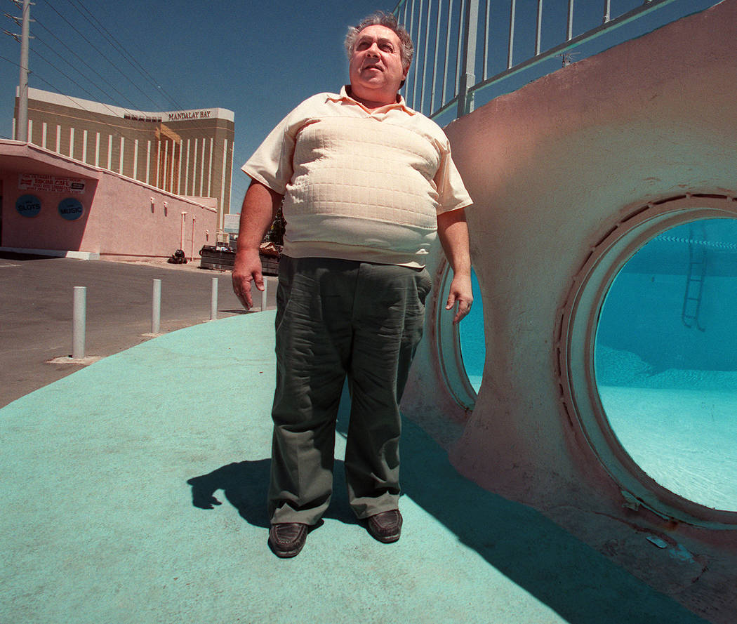 Alan Rosoff, owner of the Glass Pool Inn, stands by the distinctive swimming pool on Aug. 3, 1988, with Mandalay Bay in the background. The site was a popular place for photo shoots and appeared i ...