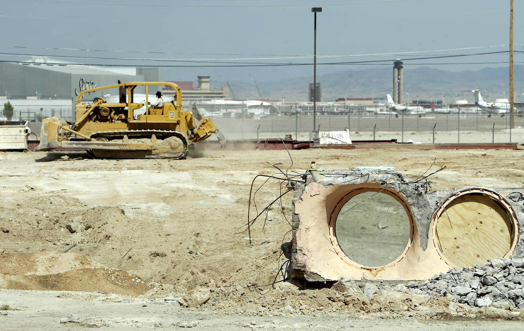 Concrete containing the pool portals from the Glass Pool Inn remain as construction equipment works nearby on Saturday, May 15, 2004. (John Locher/Las Vegas Review-Journal)