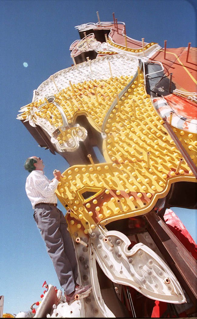 Steve Weeks climbs on the Hacienda sign on Aug. 24, 1995. (Jeff Scheid/Las Vegas Review-Journal)