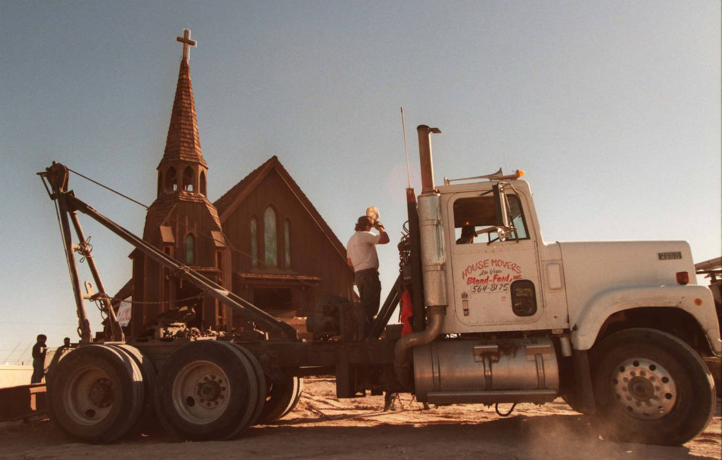 Workers from Bland-Ford House Movers moved the Little Church of the West early Wednesday, Dec. 4, 1996. The historic church was moved from the grounds of the Hacienda Hotel to a location near Las ...