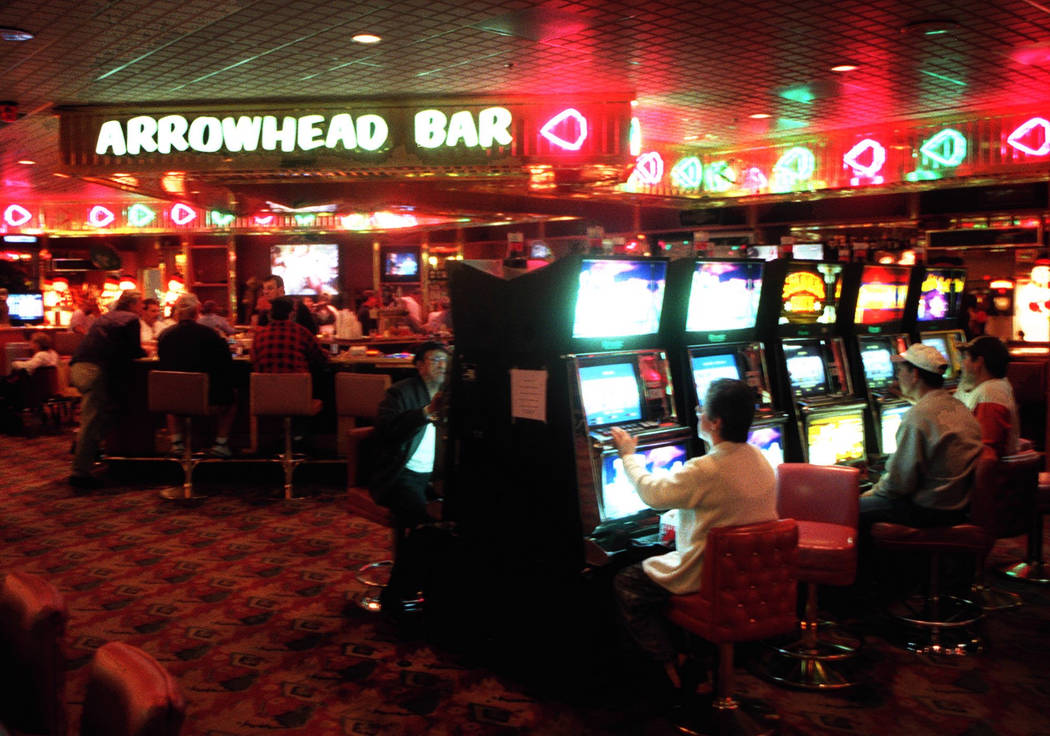 Customers play slot machines near the Arrowhead Bar at Vacation Village on Dec. 15, 2000. The hotel-casino closed in 2002 after 12 years of operation, and later became the site of the Town Square ...