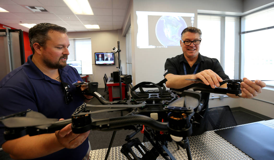 William O'Donnell, vice president of technology for AviSight, left, and Dean Keck, deputy director of Nevada Institute for Autonomous Systems, prepare a drone at NIAS's new Nevada Drone Center for ...