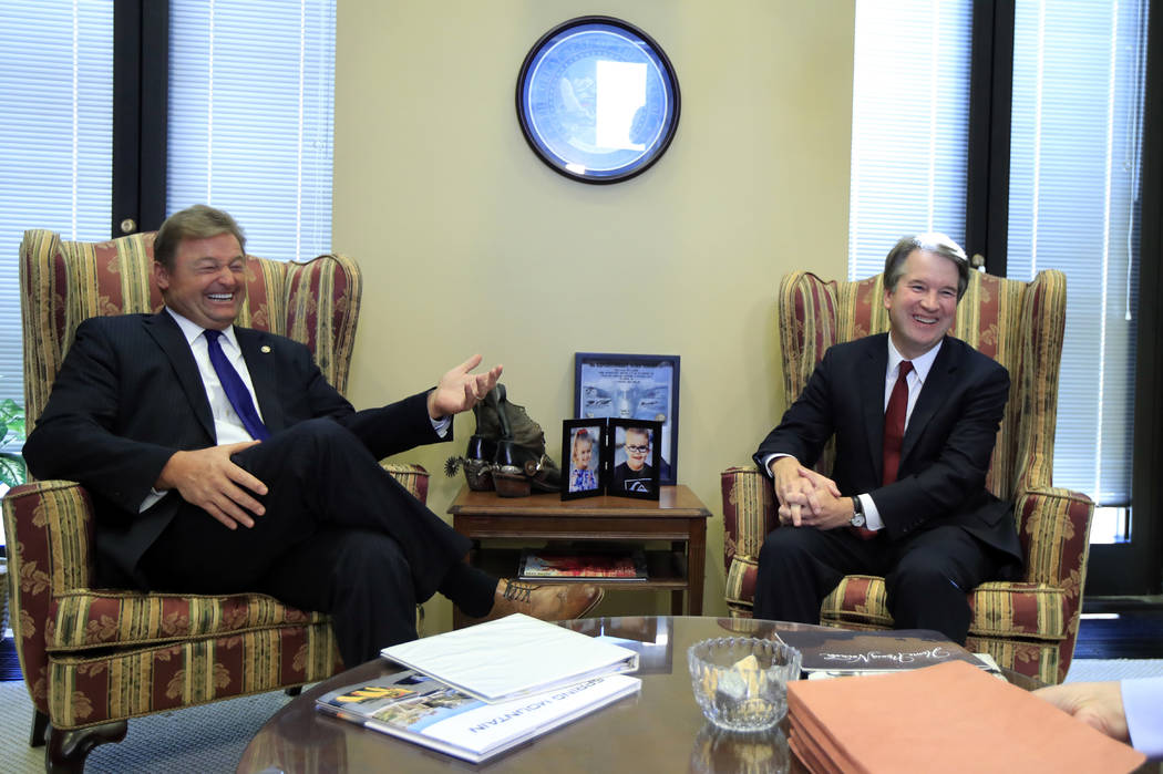 Supreme Court nominee Brett Kavanaugh, right, and Sen. Dean Heller, R-Nev., laugh during their meeting on Capitol Hill in Washington, Thursday, July 19, 2018. (AP Photo/Manuel Balce Ceneta)