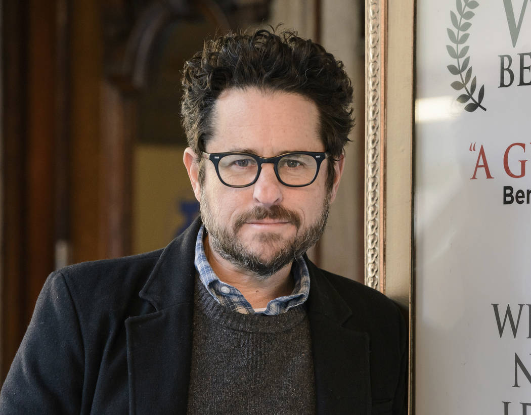 """Director-producer J.J. Abrams poses for a portrait to promote """"The Play That Goes Wrong"""" at the Lyceum Theatre in New York in 2017. (Photo by Christopher Smith/Invision/AP, File)"""
