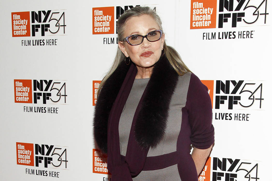 """Actress Carrie Fisher attends a special screening of, """"Bright Lights: Starring Carrie Fisher and Debbie Reynolds,"""" at Alice Tully Hall in New York in 2016. (Photo by Andy Kropa/Invision/AP)"""