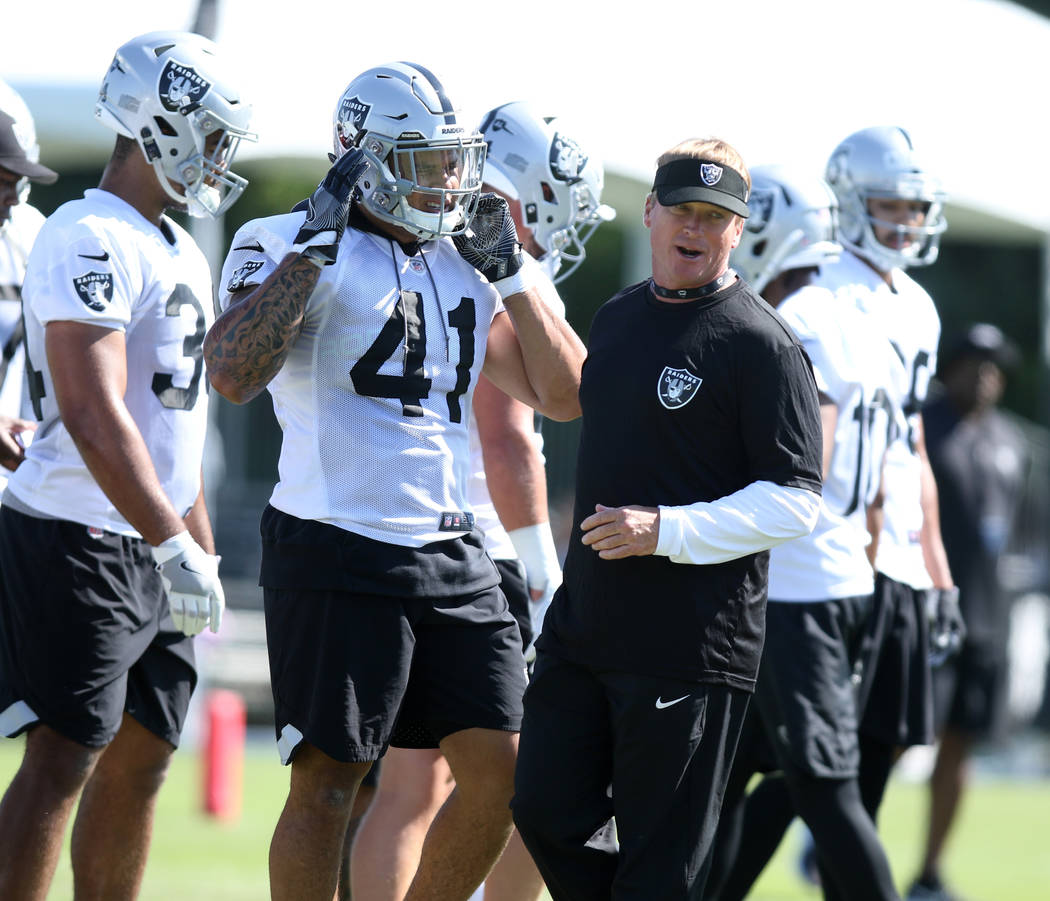 Head Coach Jon Gruden works with the offensive unit at the Oakland Raiders training camp in Napa, Calif., Friday, July 27, 2018. Heidi Fang Las Vegas Review-Journal @HeidiFang
