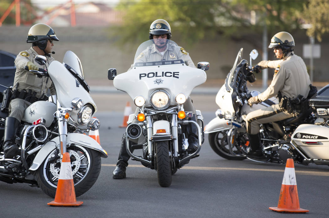 Metropolitan Police Department traffic bureau officers Ted Mondragon, from left, Michael Lemley, Ken Mancour perform stunts for onlookers during the Citywide Traffic Safety Block Party hosted by t ...