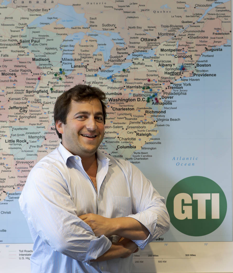 In this Wednesday, July 11, 2018, photo, Ben Kovler, CEO, Green Thumb Industries poses for a portrait at the company's office in Chicago. (AP Photo/Charles Rex Arbogast)