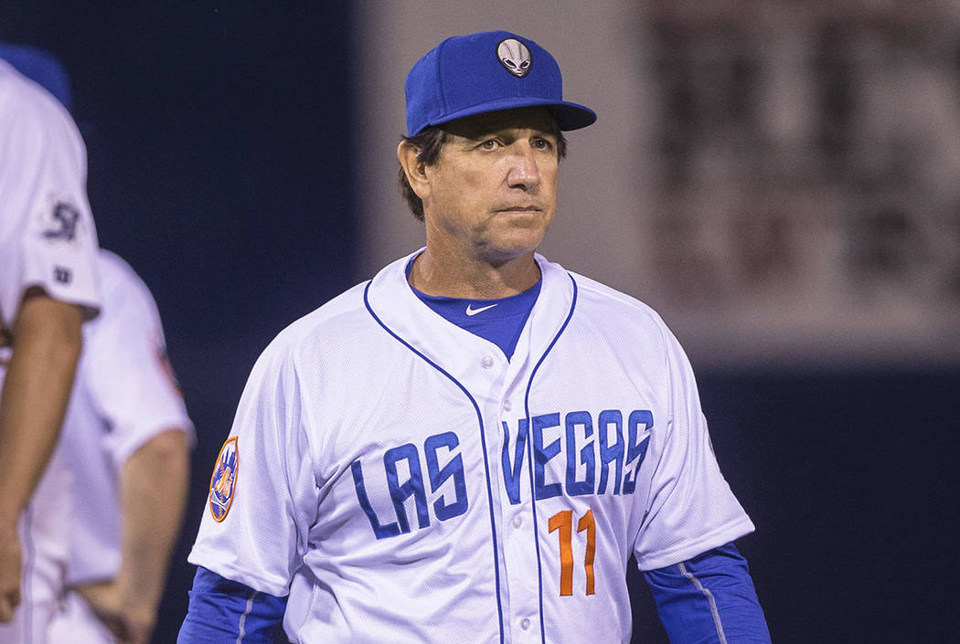 51s manager Tony DeFrancesco, right, walks back to the dugout after making a pitching change during Las Vegas' home matchup with the El Paso Chihuahuas on Monday, April 9, 2018, at Cashman Field, ...