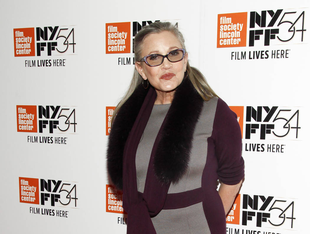 """Carrie Fisher attends a special screening of, """"Bright Lights: Starring Carrie Fisher and Debbie Reynolds,"""" at Alice Tully Hall in New York. J.J. Abrams says he will use unreleased footage of Fishe ..."""