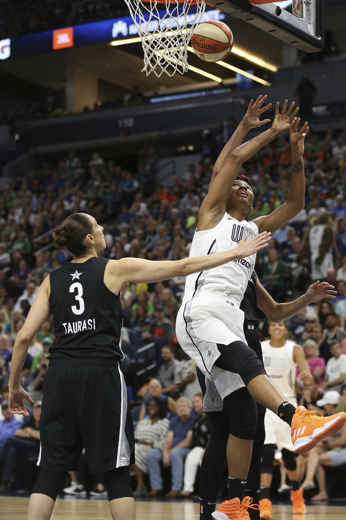 Team Candace Parker's Angel McCoughtry (35) tries to rebound the ball against Team Delle Donne's Diana Taurasi (3) in the first half of the WNBA All-Star basketball game Saturday, July 28, 2018 in ...