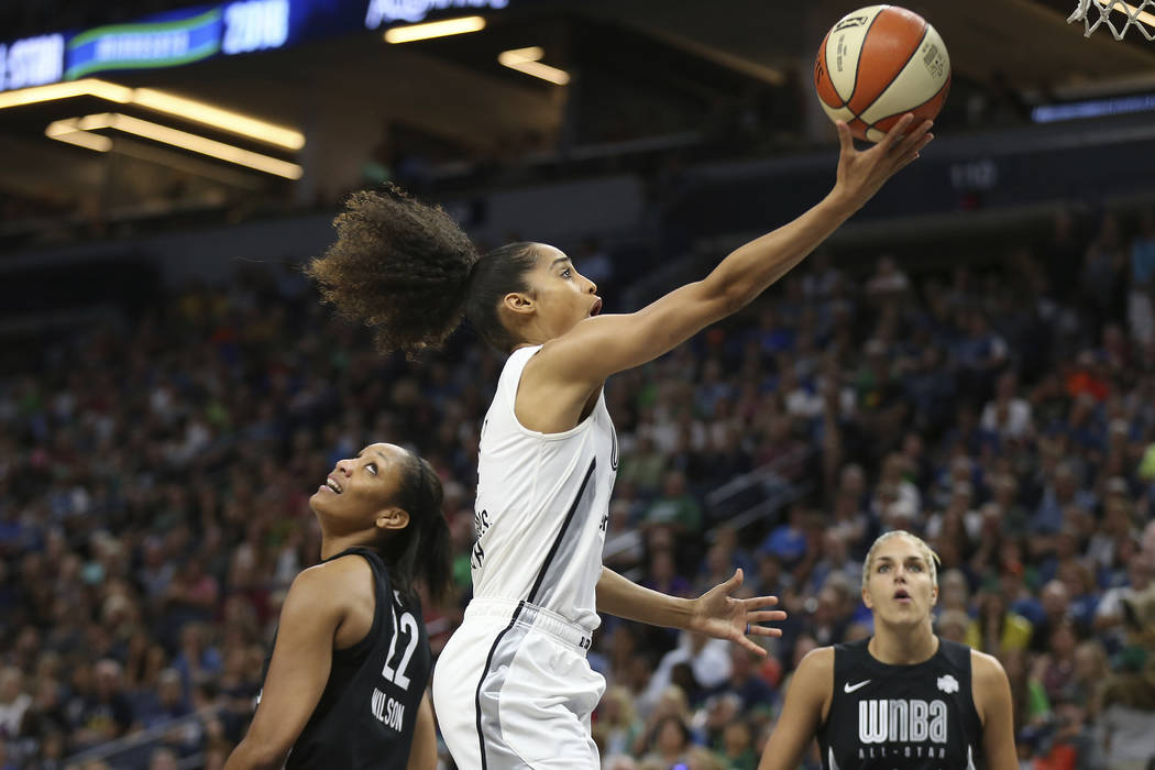 Team Candace Parker's Skylar Diggins-Smith, center, goes to the basket against Team Delle Donne's A'ja Wilson (22) in the first half of the WNBA All-Star basketball game Saturday, July 28, 2018 in ...