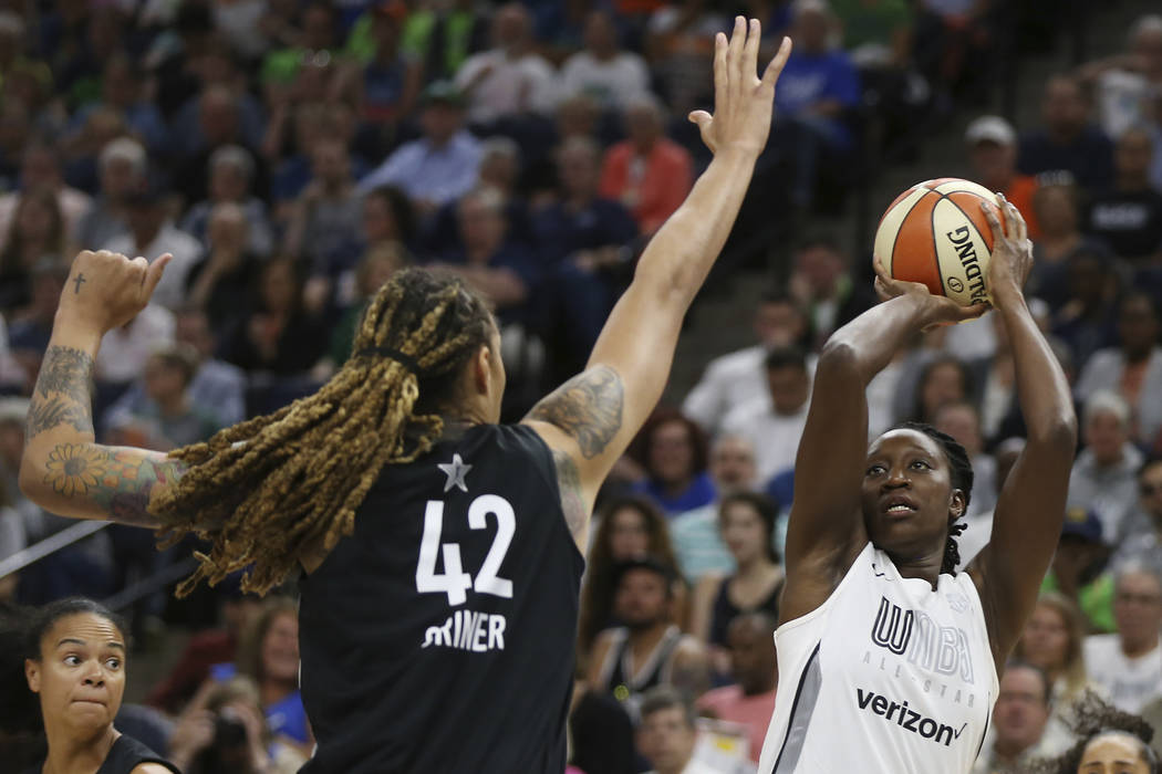 Team Candace Parker's Chelsea Gray, right, lines up a shot against Team Delle Donne's Brittney Griner, left, in the first half of the WNBA All-Star basketball game Saturday, July 28, 2018 in Minne ...