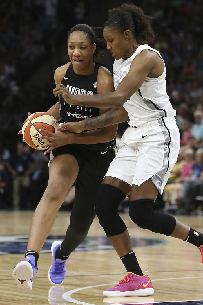 Team Delle Donne's A'ja Wilson, left, controls the ball against Team Candace Parker's Rebekkah Brunson, right, in the first half of the WNBA All-Star basketball game Saturday, July 28, 2018 in Min ...