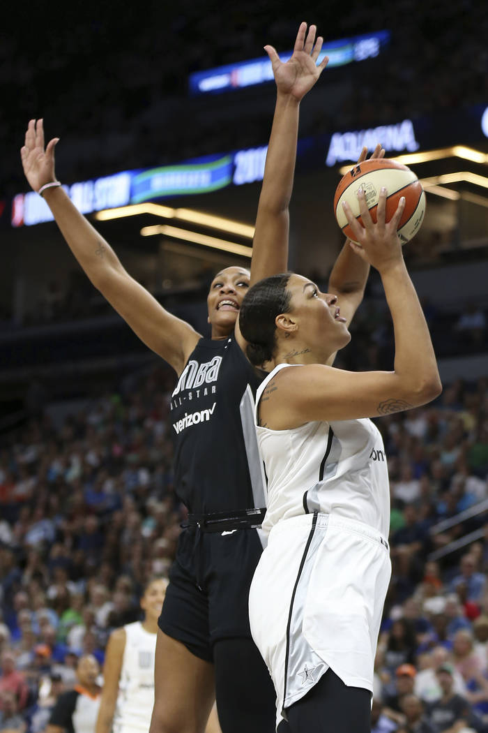 Team Candace Parker's Liz Cambage, right, shoots the ball against Team Delle Donne's A'ja Wilson, left, in the first half of the WNBA All-Star basketball game Saturday, July 28, 2018 in Minneapoli ...