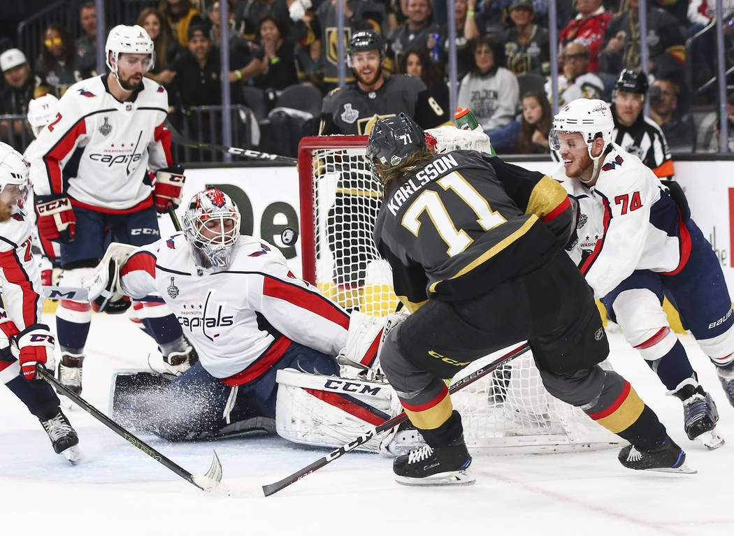 Golden Knights center William Karlsson (71) scores a goal past Washington Capitals goaltender Braden Holtby (70) during the first period of Game 1 of the NHL hockey Stanley Cup Final at the T-Mobi ...